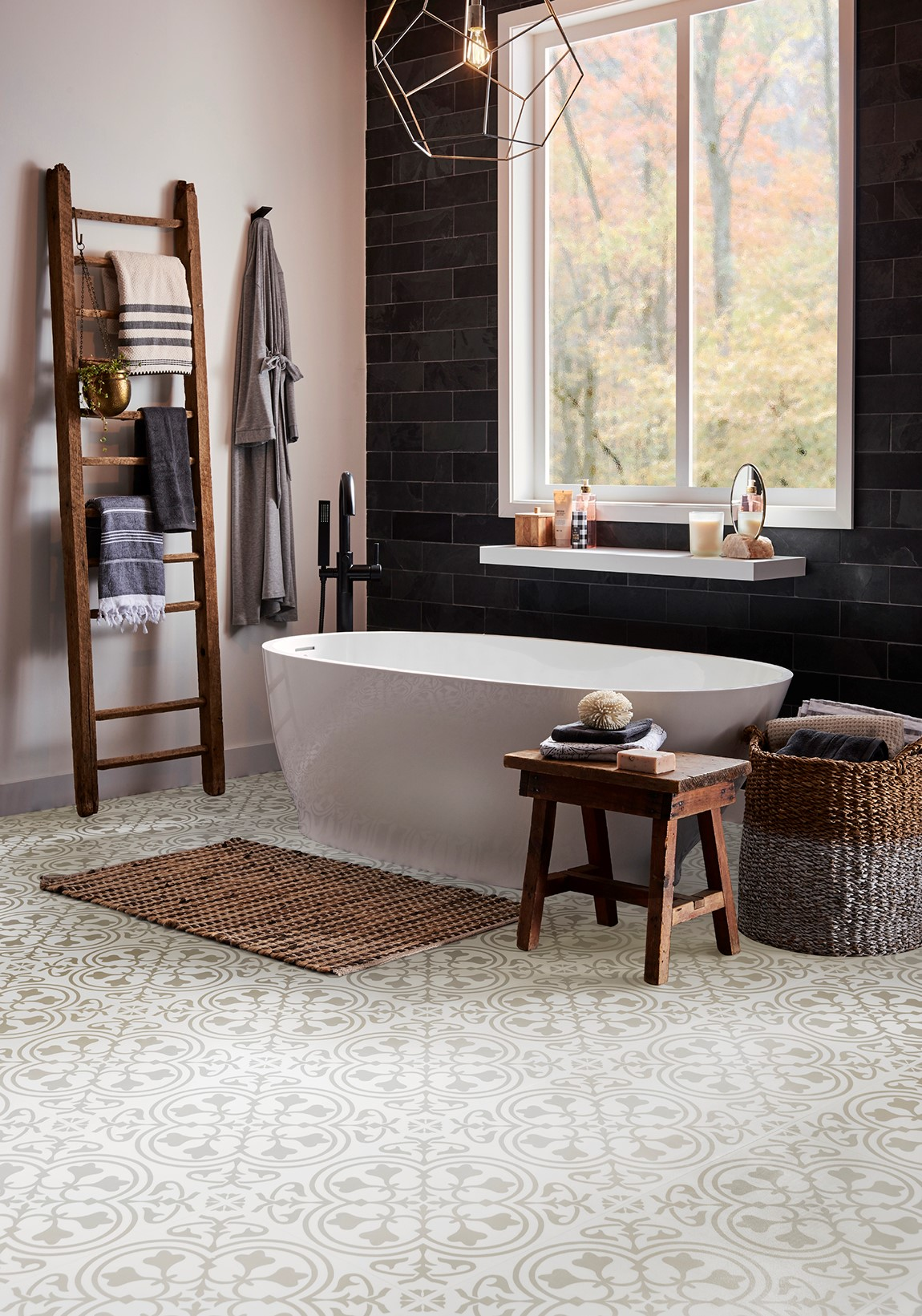 large bathroom with free standing tub and patterned lvt floor